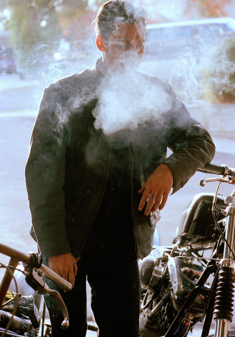 ryan-smith-smoking-in-garage-with-bike-2008-adjust-DUP.jpg